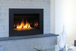 Ravennacdg the ravenna cd fireplace insert radiates style and warmth with dancing flames that fill the porcelain lined firebox teraionfo